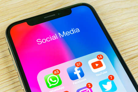 Sankt-Petersburg, Russia, September 2, 2018: Apple iPhone X with icons of social media facebook, instagram, twitter, application on screen. Social media icons. Social network