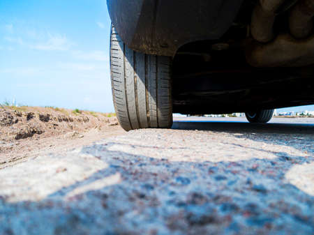 Tire and alloy wheel of a modern car on the ground. Car exterior details. Car detailing.