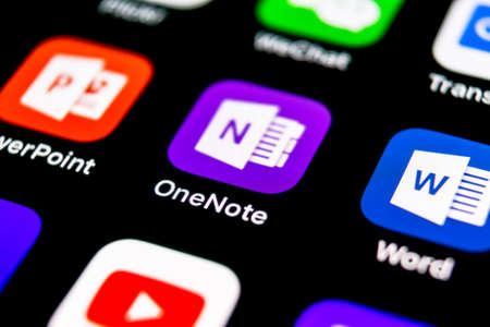 Sankt-Petersburg, September 30, 2018: Microsoft OneNote office application icon on Apple iPhone X screen close-up. Microsoft One Note app icon. Microsoft OneNote application. Social media network