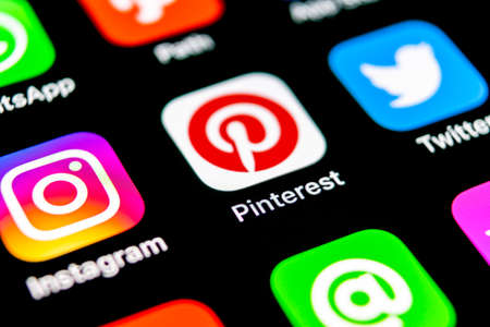 Sankt-Petersburg, Russia, September 30, 2018: Pinterest application icon on Apple iPhone X smartphone screen. Pinterest app icon. Pinterest is the popular Internet social network. Social media icon