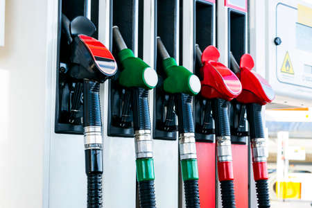Gasoline and diesel distributor at the gas station. Gas pump nozzles. Petrol filling gun close-up at the gas station. Colorful Petrol pump filling nozzles. Fuel pump Stock Photo