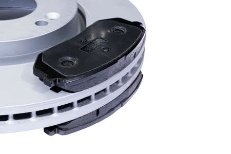 Brake discs and brake pads isolated on white background. Auto parts. Brake disc rotor isolated on white. Braking disk. Car part. Car detailing. Spare parts