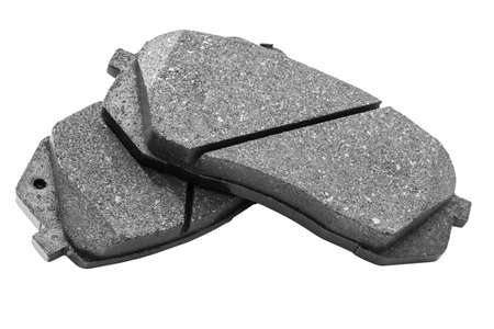 Brake pads isolated on white background. Auto parts. Brake pads isolated on white. Braking pads. Car part. Car detailing. Spare parts Stock Photo