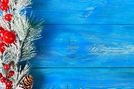 Christmas concept. Christmas fir tree with decoration on rustic vintage board. Pine branches. Fir cones. Snow on wood. Xmas and Happy New Year composition. Copy space. Empty space. Top view. Christmas background Stock Photo