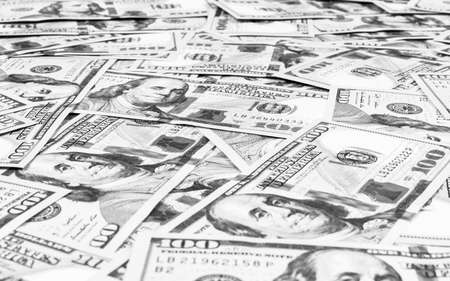 Stack of one hundred dollar bills. Stack of cash money in hundred dollar banknotes. Heap of hundred dollar bills background. Concept of financial success. Black and white. Money background