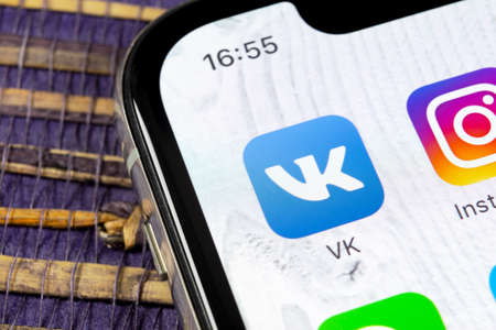 Sankt-Petersburg, Russia, December 5, 2018: Vkontakte application icon on Apple iPhone X screen close-up. VK app icon. Vkontakte mobile application. Social media network. Social media icon