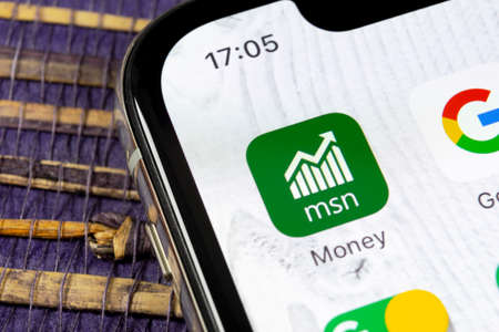 Sankt-Petersburg, Russia, December 5, 2018: Microsoft MSN money application icon on Apple iPhone X smartphone screen close-up. Microsoft msn money app icon. Social network. Social media icon Editorial