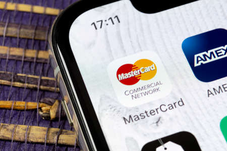 Sankt-Petersburg, December 5, 2018: MasterCard application icon on Apple iPhone X screen close-up. Master Card icon. MasterCard online application. Social media app