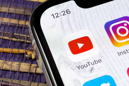 Sankt-Petersburg, Russia, December 5, 2018: YouTube application icon on Apple iPhone X smartphone screen close-up. Youtube app icon. Social media icon. Social network