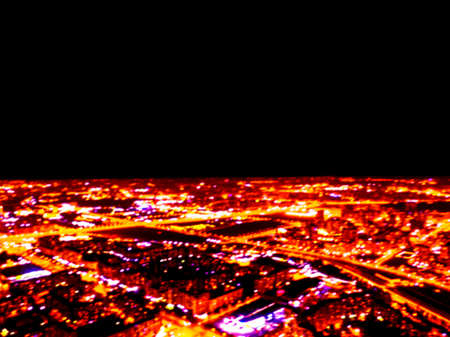 Abstract Blurred background Aerial night view of a big city. Cityscape panorama bokeh at night. Blurry Aerial view of skyscraper and road with car at night time. Blur Top view from above. Bokeh light Фото со стока