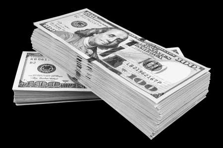 Stack of one hundred dollar bills isolated on black background. Stack of cash money in hundred dollar banknotes. Heap of hundred dollar bills background. Concept of financial success.