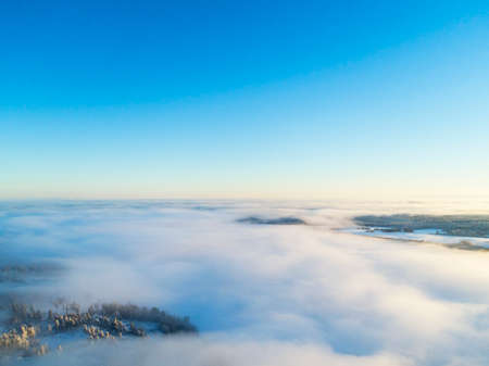 Aerial view clouds over forest during winter colors. Aerial view of forest and clouds. Coastline. Aerial drone view of the forest. Aerial top view cloudscape. Texture of clouds.