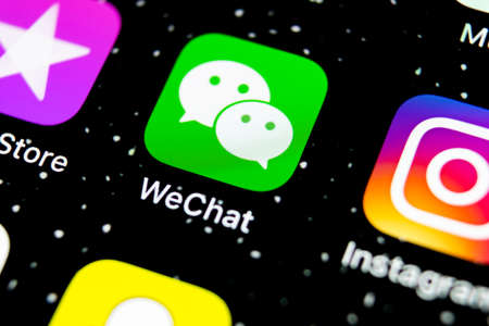 Sankt-Petersburg, Russia, February 3, 2019: Wechat messenger application icon on Apple iPhone X smartphone screen close-up. Wechat messenger app icon. Social media network. Stock Photo - 116832026