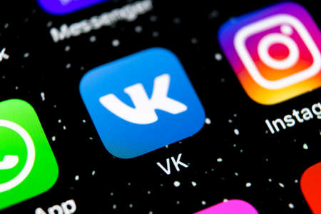 Sankt-Petersburg, Russia, February 3, 2019: Vkontakte application icon on Apple iPhone X screen close-up. VK app icon. Vkontakte mobile application. Social media network. Social media icon