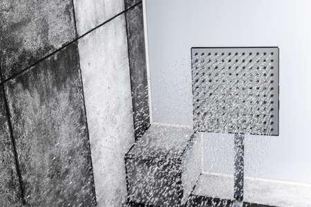 Fresh shower. Head shower with running water. Shower with drops of water. Drops and streams of water. Running water of shower faucet. Falling water drops
