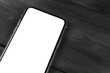 Smartphone with blank screen mock up. Smartphone isolated screen. Mobile phone white screen with copy space on office desk. Empty space for text. Isolated white screen