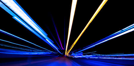 Cars light trails on a curved highway at night. Night traffic trails. Motion blur. Night city road with traffic headlight motion. Cityscape. Light up road by vehicle motion blur. Abstract view Cars on motion with long exposure