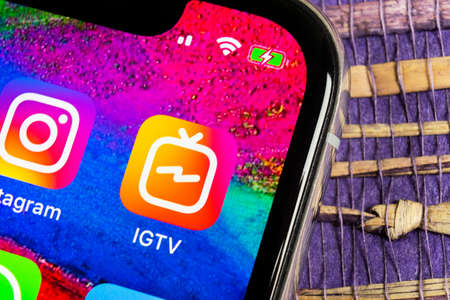 Helsinki, Finland, February 17, 2019: Apple iPhone X with social networking service IGTV Instagram on the smartphone screen close-up. IGTV app icon. Social media icon. Social network. IGTV mobile application