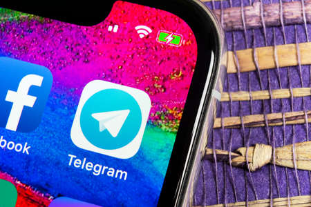 Helsinki, Finland, February 17, 2019: Telegram application icon on Apple iPhone X screen close-up. Telegram app icon. Telegram is an online social media network. Social media app