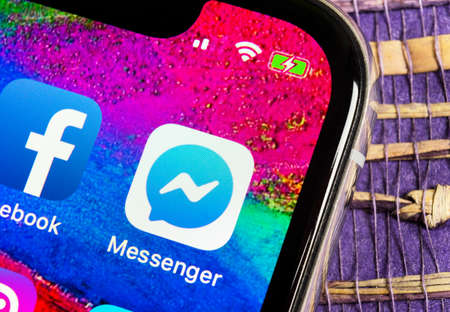 Helsinki, Finland, February 17, 2019: Facebook messenger application icon on Apple iPhone X screen close-up. Facebook messenger app icon. Online internet social media network. Social media app