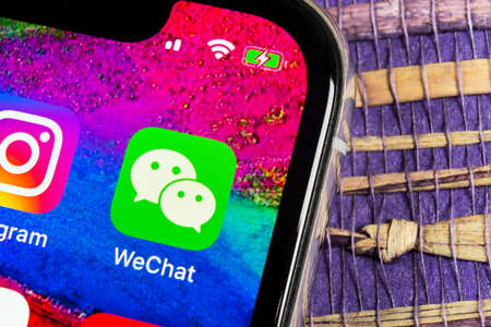 Sankt-Petersburg, Russia, February 17, 2019: Wechat messenger application icon on Apple iPhone X smartphone screen close-up. Wechat messenger app icon. Social media network. Editorial