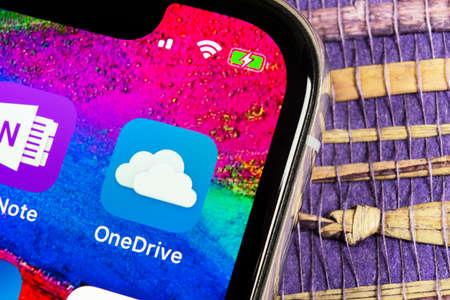 Helsinki, Finland, February 17, 2019: Microsoft OneDrive application icon on Apple iPhone X screen close-up. Microsoft onedrive app icon. Microsoft office OneDrive application. Social media network