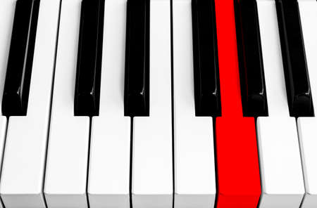 Top view of piano keys with one red button. Close-up of piano keys. Close frontal view. Piano keyboard with selective focus. Diagonal view. Piano keyboard perspective.