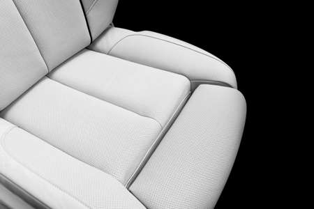 White leather interior of the luxury modern car. Perforated white leather comfortable seats with stitching. Modern car interior details. Car detailing. Car inside. Leather texture background Reklamní fotografie