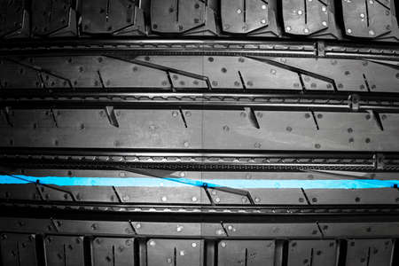 Car tire. Tire stack. Car tyre protector close up. Black rubber tire. Brand new car tires. Close up black tyre profile.