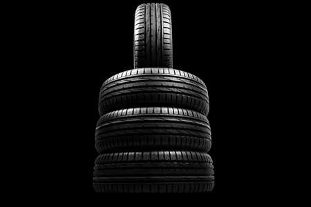 Car tire isolated on black background. Tire stack. Car tyre protector close up. Black rubber tire. Brand new car tires. Close up black tyre profile. Car tires in a row Stockfoto