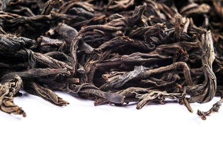 Macro shot of a high quality black tea on white background. Black tea background close up. Leaf closeup. Background of dried tea leaves of dark color. Pile of black tea leaves. 免版税图像 - 121954915