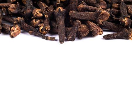 Macro shot of Carnation grains. Herbal medicinal herbs. Dry carnation grains background. Dry spice cloves or carnation isolated on white background 写真素材