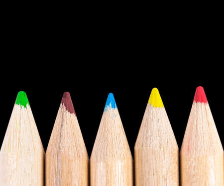 Set of color pencils isolated on black background. Multicolored pencils isolated. 写真素材