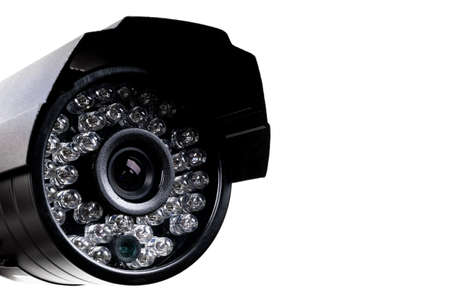 CCTV security camera video equipment. Surveillance monitoring. Video camera lens closeup. Macro shot. Security concept. Security camera isolated on white background
