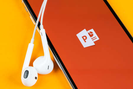 Helsinki, Finland, May 4, 2019: Microsoft office Powerpoint application icon on Apple iPhone X screen close-up. PowerPoint app icon. Microsoft Power Point application. Social media network