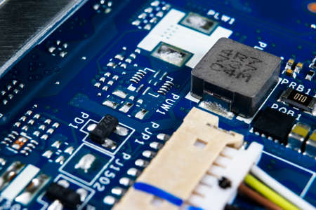 Macro shot of Circuit board with resistors microchips and electronic components. Computer hardware technology. Integrated communication processor. Information engineering. Semiconductor. PCB. Closeup 写真素材