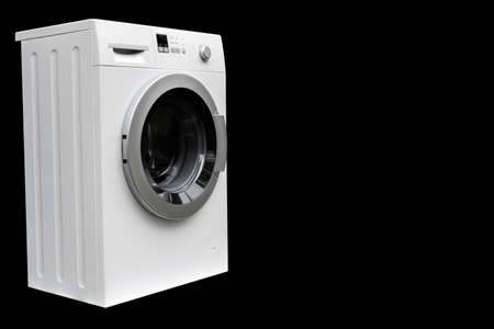 Washing machine isolated on black background. Washing machine isolated over black. Stockfoto