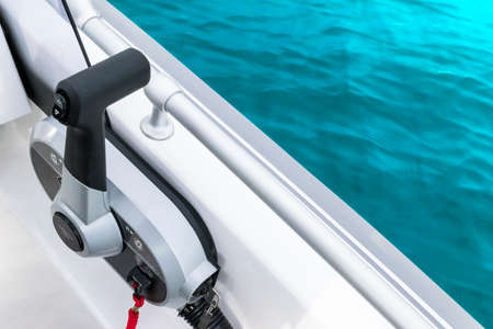 Close up throttle lever on motor boat or central gear on luxury fishing boat. Boat steering gear close up 写真素材
