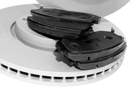 Brake discs and brake pads isolated on white background. Auto parts. Brake disc rotor isolated on white. Braking disk. Car part. Car detailing. Spare parts. Black and white 写真素材
