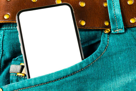 Smartphone mockup in jeans pocket. Modern black frameless smartphone with blank white screen. Empty space for text. Copy space. Isolated white screen 写真素材