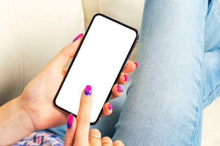 Smartphone mockup in woman hand. New modern black frameless smartphone mock up with blank white screen. Empty space for text. Copy space. Isolated white blank screen. 写真素材 - 124849976