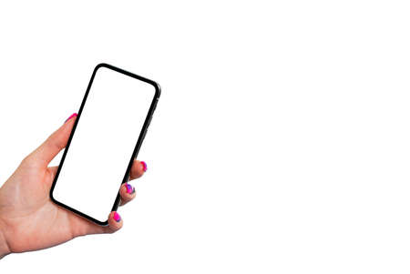 Smartphone mockup in woman hand isolated on white background. Modern frameless smartphone mock up with blank white screen. Empty space for text. Copy space. Isolated white screen. 写真素材