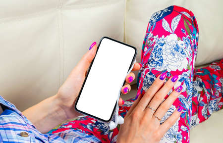 Smartphone mockup in woman hand. New modern black frameless smartphone mock up with blank white screen. Empty space for text. Copy space. Isolated white blank screen. 写真素材 - 124867099