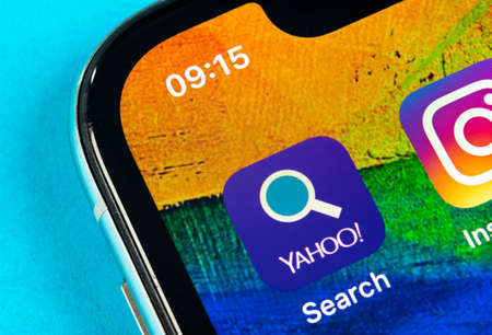 Helsinki, Finland, May 4, 2019: Yahoo search application icon on Apple iPhone X smartphone screen close-up. Yahoo search app icon. Social network. Social media icon 報道画像