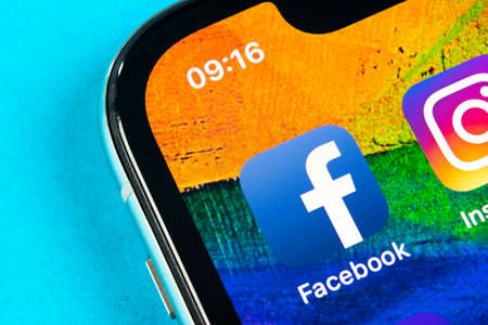 Helsinki, Finland, May 4, 2019: Facebook application icon on Apple iPhone X smartphone screen close-up. Facebook app icon. Social media icon. Social network 報道画像