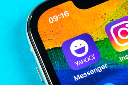 Helsinki, Finland, May 4, 2019: Yahoo messenger application icon on Apple iPhone X smartphone screen close-up. Yahoo messenger app icon. Social media icon. Social network