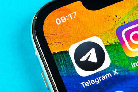 Helsinki, Finland, May 4, 2019: Telegram X application icon on Apple iPhone X screen close-up. Telegram X app icon. Telegram X is an online social media network. Social media app Stock Photo - 128141230