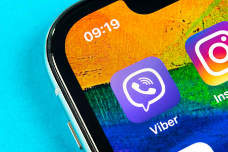 Helsinki, Finland, May 4, 2019: Viber application icon on Apple iPhone X smartphone screen close-up. Viber app icon. Social media icon. Social network