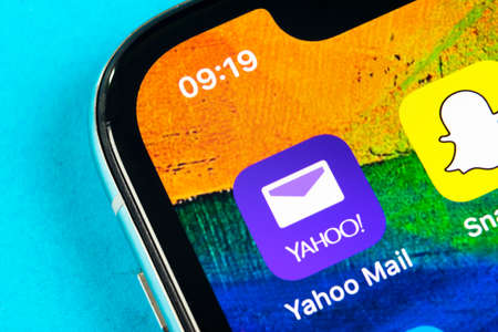 Helsinki, Finland, May 4, 2019: Yahoo Mail application icon on Apple iPhone X smartphone screen close-up. Yahoo mail app icon. Social network. Social media icon 報道画像