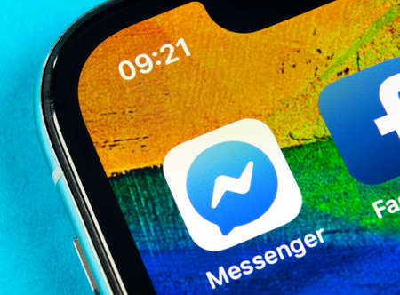Helsinki, Finland, May 4, 2019: Facebook messenger application icon on Apple iPhone X screen close-up. Facebook messenger app icon. Online internet social media network. Social media app 報道画像